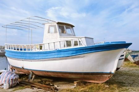 wheelhouse: Boat On The Shore In The Fishing Port