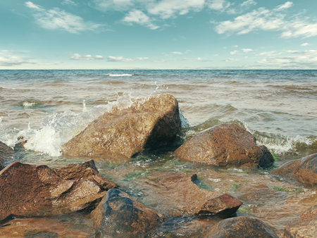 over the sea: Coastline Of The Sea With Rocks And Blue Sky Over It