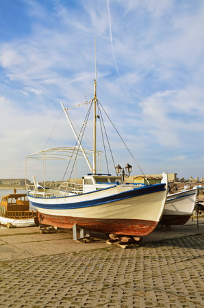 boat motor: Boats On The Shore In The Fishing Port