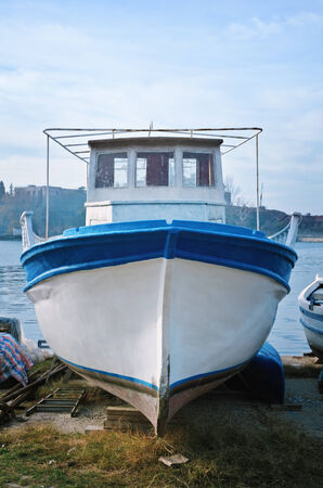 keel: Boat On The Shore In The Fishing Port