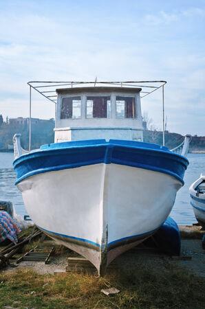 wheelhouse: Boat On The Shore In The Fishing Port