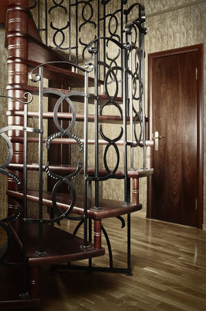 Spiral Staircase With Metal Railing In The Entrance Hall photo