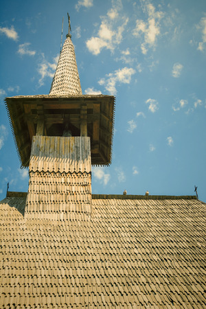 bell tower: Wooden Bell Tower Under The Blue Sky. Vintage Effect