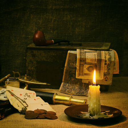 Still life in candle light with old things Stock Photo