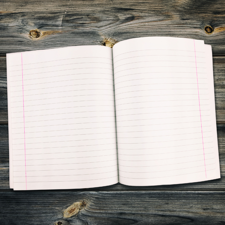 margins: Open Notebook On The Wooden Background