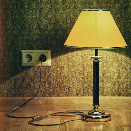 baseboard: Turned On Old Lamp Near The Wall. Reto Stylized Image