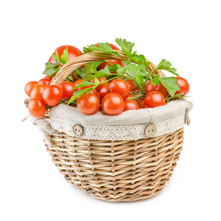 viands: Basket With Tomatoes Over The White Background