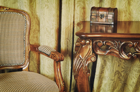 vintage furniture: Fragment Of The Interior With Antique Furniture And Coffret On The Table Stock Photo