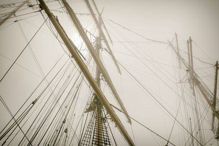 rigging: Masts Of Sailboats In The Fog