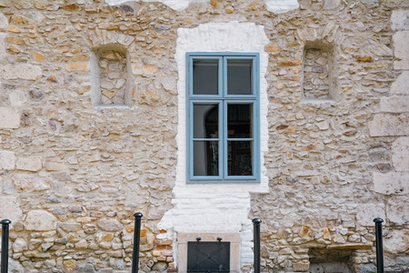 stone wall: Old Stone Wall of Medieval House with Closed Window