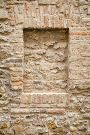 architectural exteriors: Brick Wall of an Old House with Brick-encased Window Stock Photo