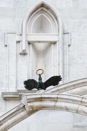 architectural exteriors: Architectural Detail: a Bird with Golden Ring