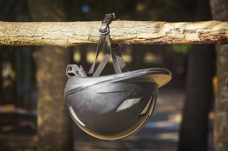 crash helmet: Helmet Hanged on the Wooden Beam Stock Photo