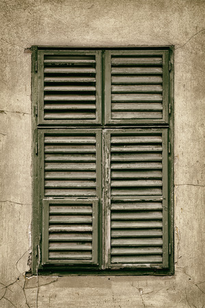 wooden window: Window Closed with Green Wooden Shutters