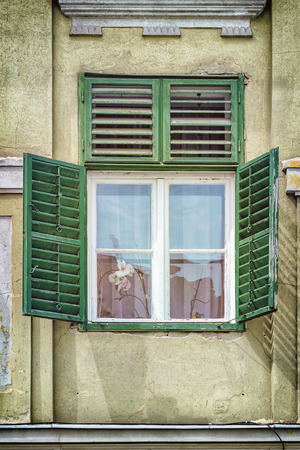old house window: Old House Window with Open Wooden Shutters Stock Photo