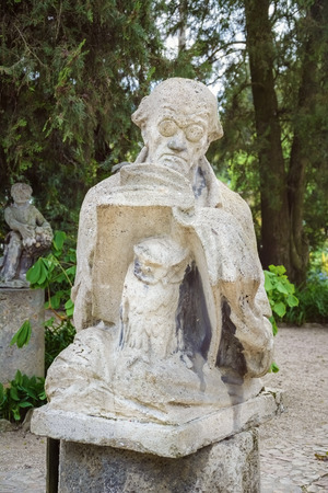 erudition: Monument of Man with the Book and an Owl Stock Photo