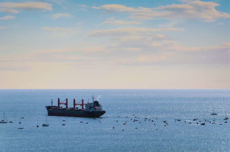 Bulk carrier: A lot of Small Boats around of Bulk Carrier
