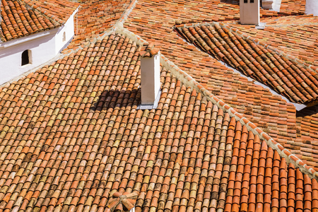 smokestack: An Old Roof from Terracotta Tiles Stock Photo