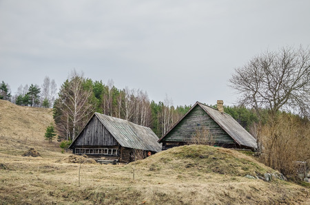 architectural exteriors: Old Wooden Houses in the Latvian Village Stock Photo
