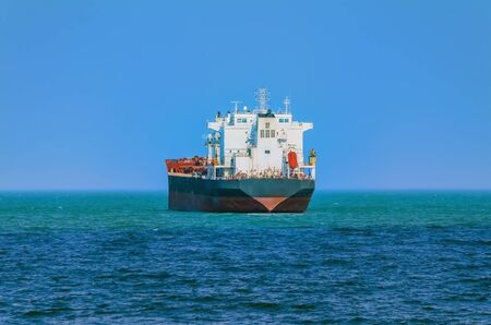 wheelhouse: Bulk Carrier Goes out to the Open Sea Stock Photo