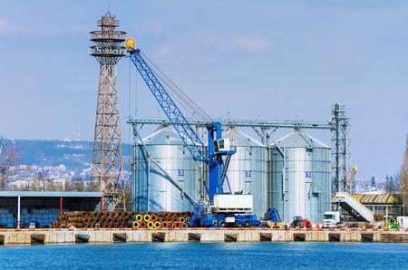 Grain Elevator in the Port. Steel Grain Bins.