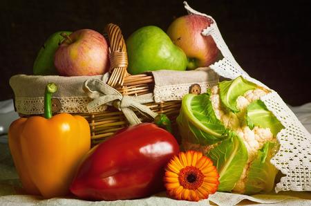 african basket: Still Life of Vegetables and Fruits
