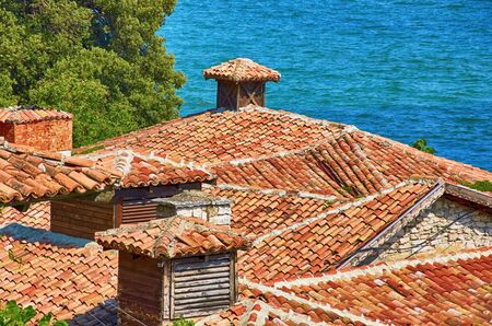 smokestack: An Old Roofs from Terracotta Tiles