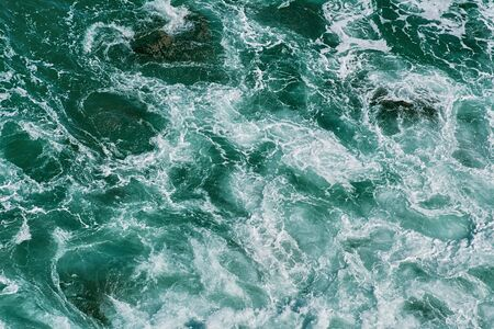 water waves: Sea Surf on the Rocky Shore