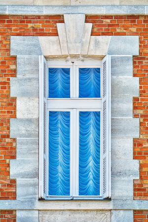 architectural exteriors: Window of an Old House with Curtains