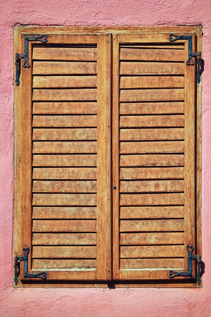 wooden window: Old Wooden Shutters on the Pink Wall Stock Photo