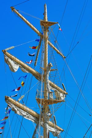 shrouds: Mast of a Sailing Ship against Blue Sky