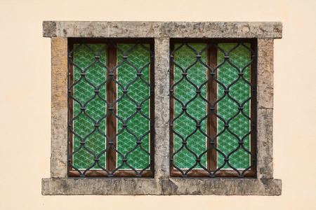 barred: Two Barred Windows of Yellow Old House