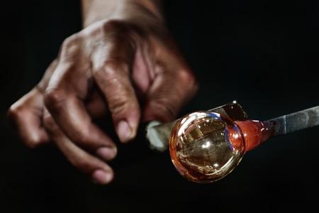 glassblower: Work of Glass Blower - Glassblower Makes the Sphere