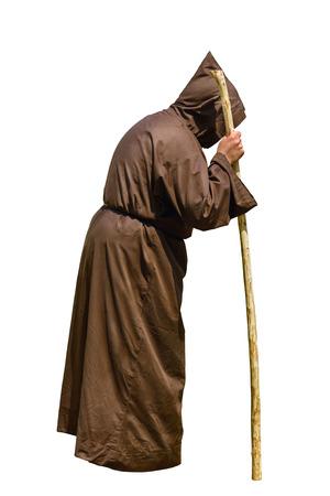 sotana: Monk con un palillo sobre el fondo blanco