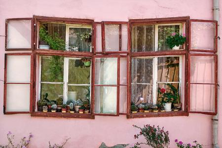 abode: Windows of an Old Building in Sigisoara, Romania