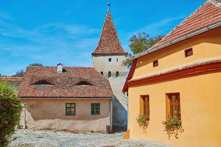 apartment tower old town: Street in Old Town of Sighisoara, Romania Stock Photo