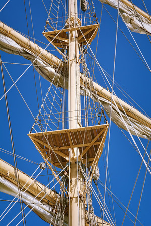 shrouds: Mast of Sailboats against the Blue Sky