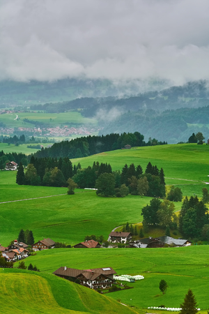 Aerial View on Obermaiselstein in the Fog. Oberallgau, Germany Stock Photo
