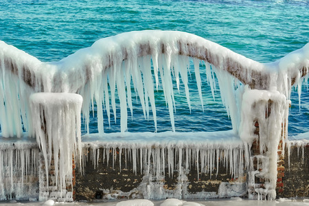 Icy Arch with Icicles on a Background of the Sea 스톡 콘텐츠