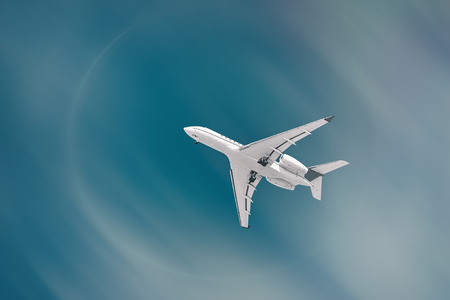 White Plane with Landing Gear in the Sky Stock Photo