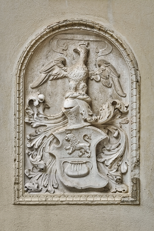 Bas-relief in the Form of a Coat of Arms on the Wall of an Old Building