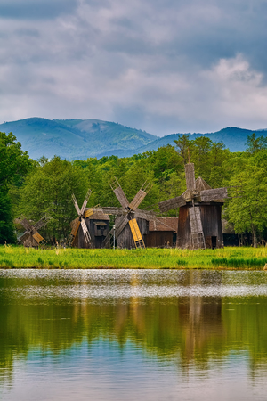 Windmills on the Bank of Lake in Romania