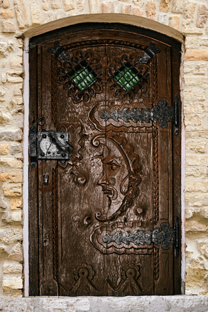 An old wooden door with the fretwork Stock Photo