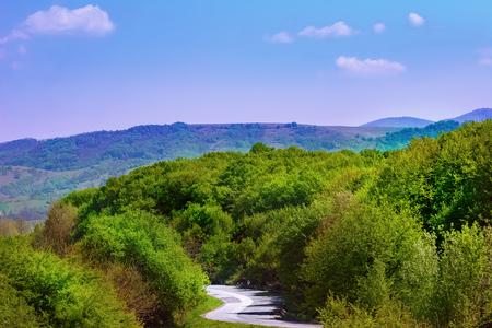 Carpathian mountains under blue sky in Romania Stock Photo
