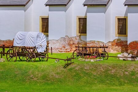 An Old Covered Wagon in the Courtyard