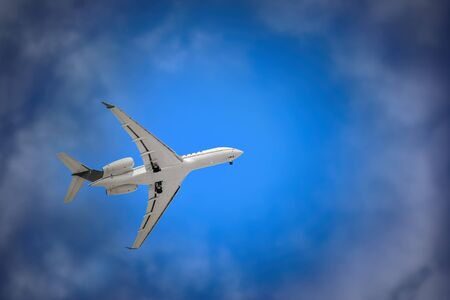 White Plane with Landing Gear in the Sky Imagens