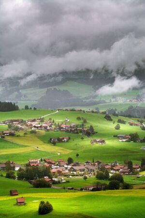 Aerial View on Obermaiselstein in the Fog. Oberallgau, Germany Zdjęcie Seryjne