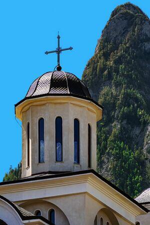 Caraiman Monastery Church against the Peak of Bucegi Mountains 版權商用圖片