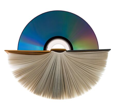 compact disk: A book with open pages and compact disk on white. Stock Photo
