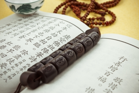 the scriptures: Buddhist or Hindu prayer beads,scripture